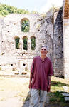 Professor David Chanatry stands in front of the basilica at Butrint