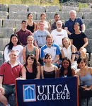 UC's international archaeological field school team poses on the steps of Butrint's theater, which was built by the Greeks and later remodeled by the Romans.