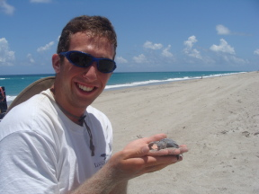 Matt with sea turtle hatchling