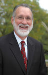 Dr. Todd S. Hutton, President of Utica College
