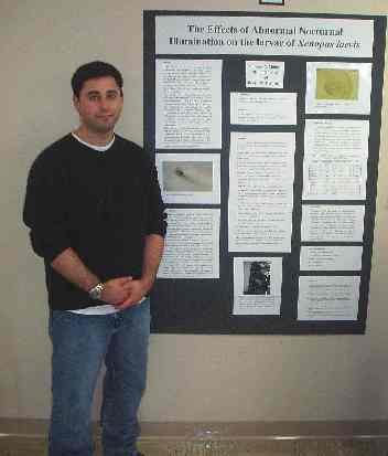 A student presents research in biology.