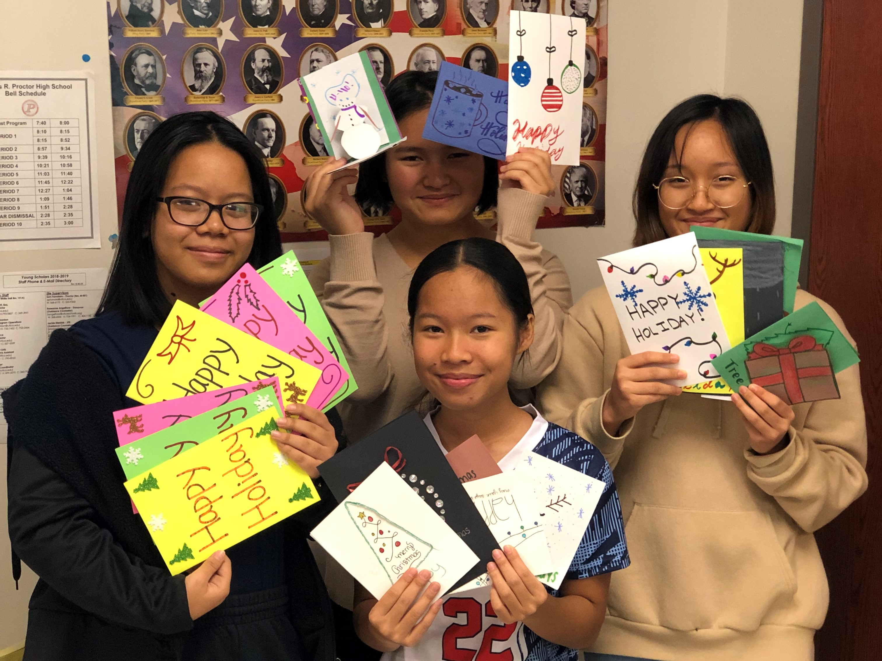 Proctor Young Scholars show off their Holiday Cards for Heros