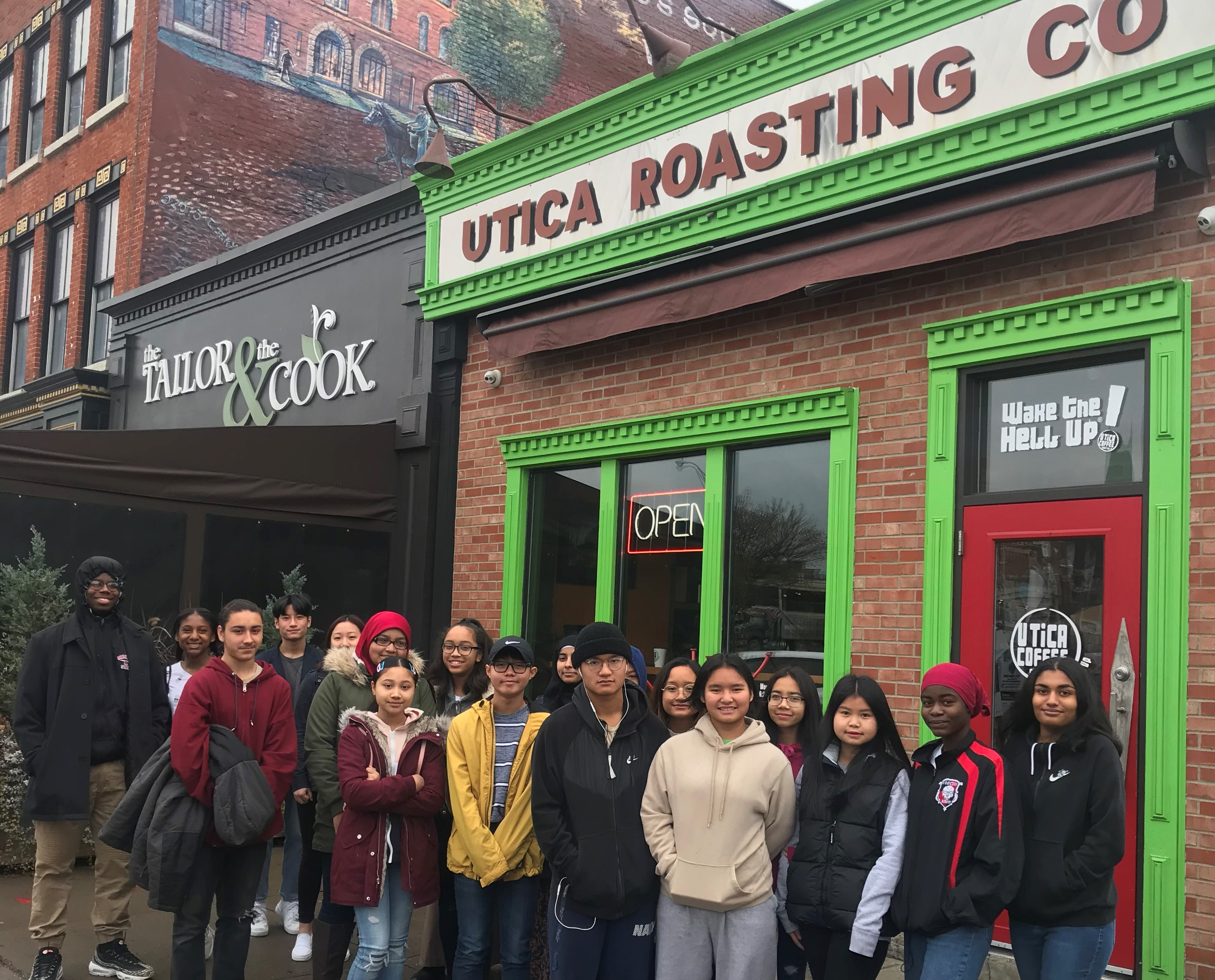 YSLPP students pose outside of Utica Coffee before their tour