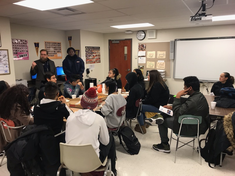 Utica College HEOP & CSTEP staff talk to Young Scholars & friends over pizza