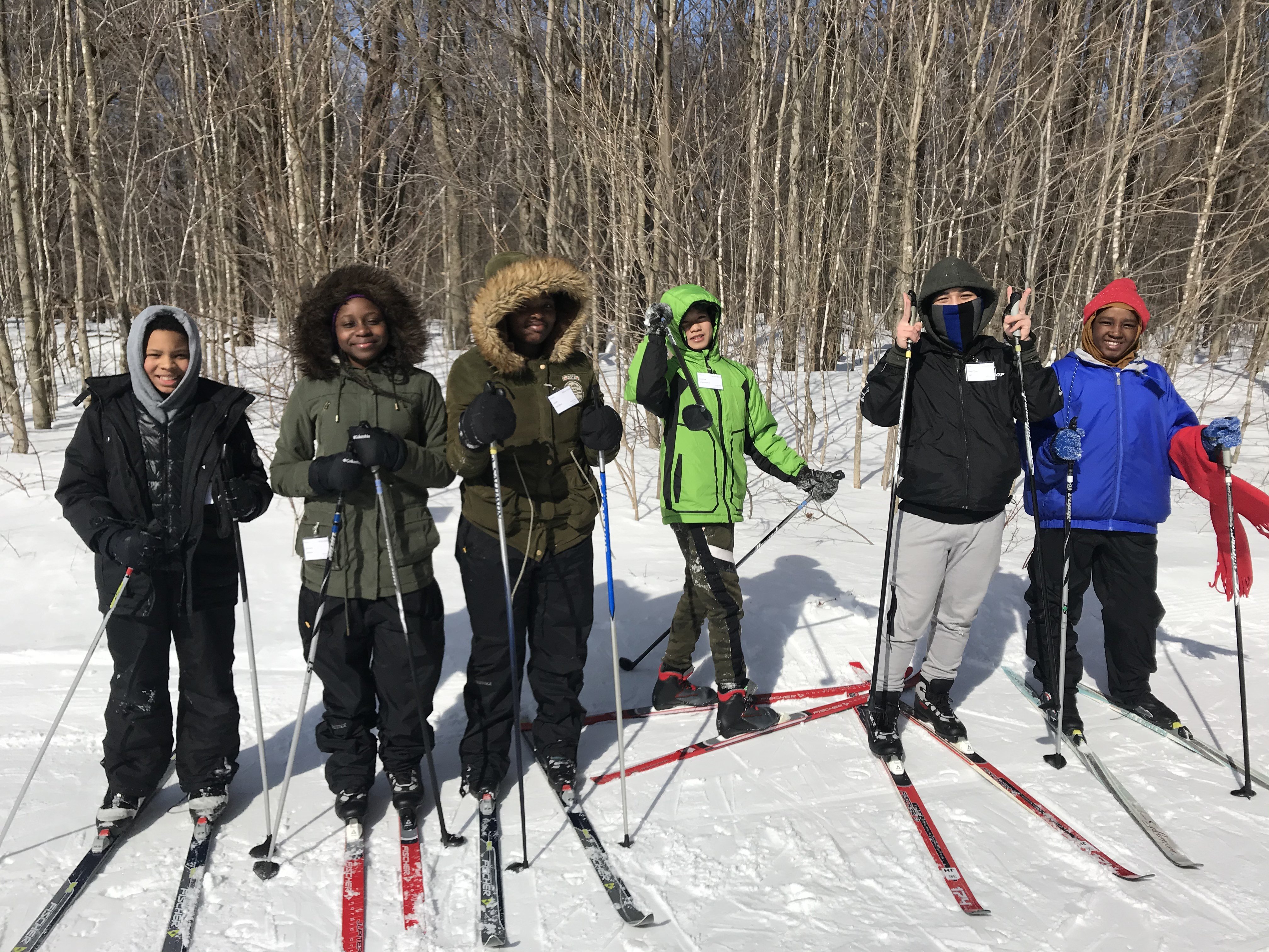 JFK students pose before cross-country skiing at Black River Outdoor Education Program