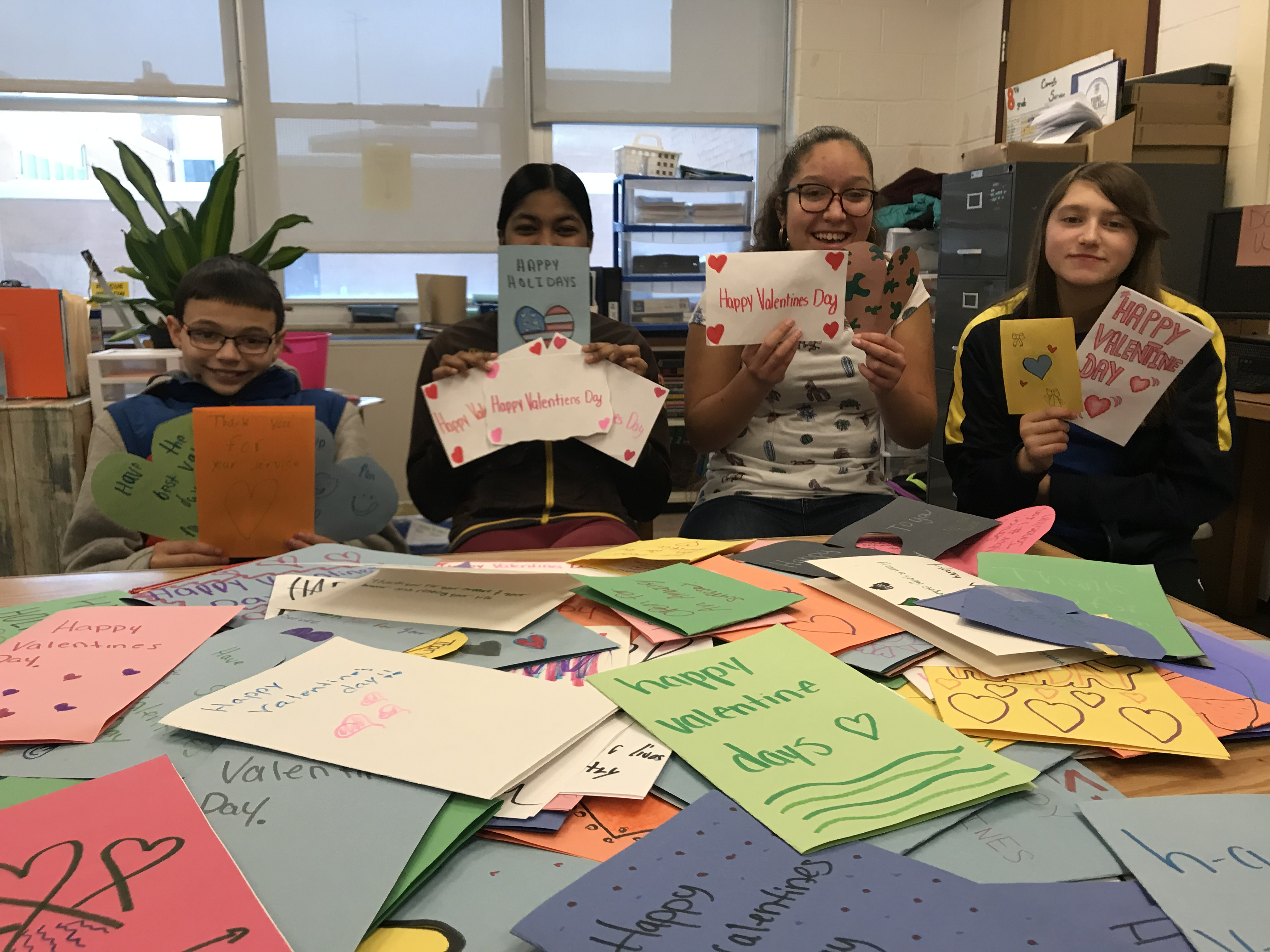 Our JFK students show off handmade Valentines Day cards they made for veterans