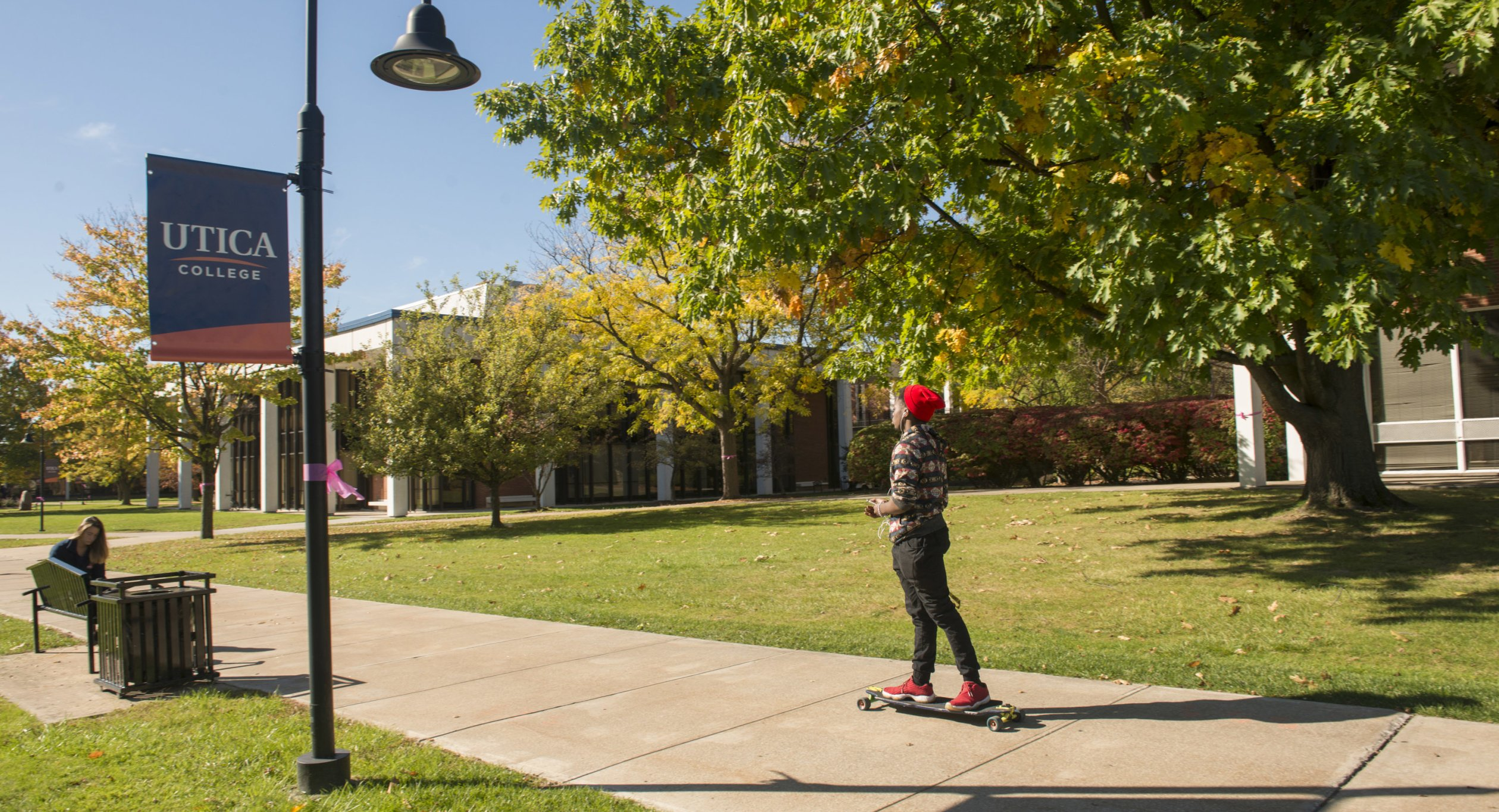 Fall Campus with Skateboarder