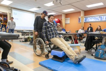 Students use Wheelchair in Physical Therapy Lab 0557