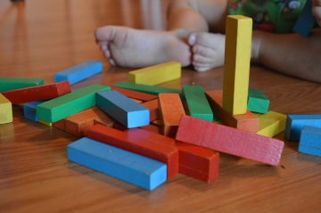 Child playing with blocks fallen over generic