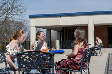 Students outside Deperno laughing - Spring Scenics_008