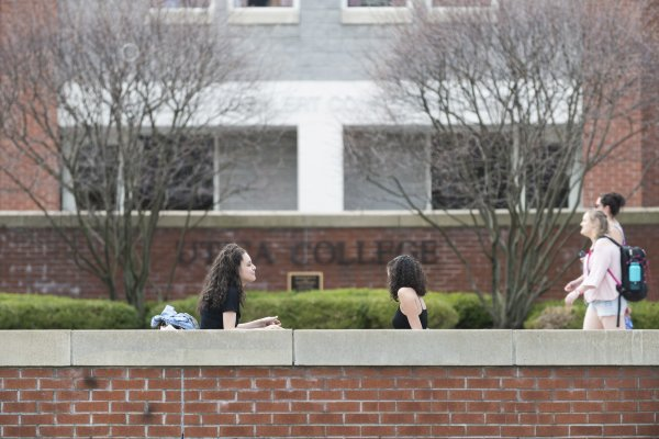 Campus Scenic - Spring - Women Sitting in front of Boehlert Hall