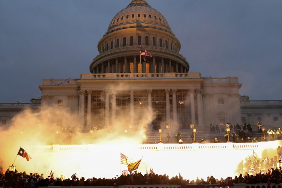 Smoke rises amid mobs assaulting the captiol on January 6, 2021.