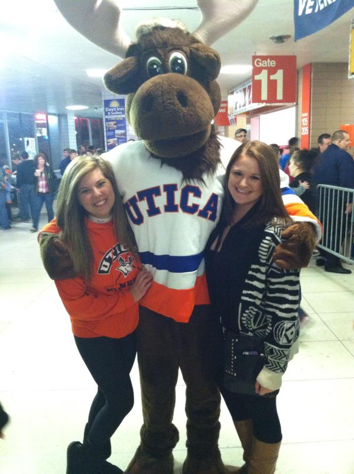Left to right: Me, Trax, and my friend Sarah at a UC hockey game during our freshman year