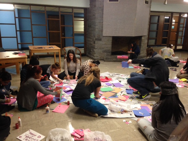This is just one of the many groups of students who were making Valentines at the event last week. We put newspaper on the floor to minimize the amount of glitter mess- it's a tricky hazard of crafting!