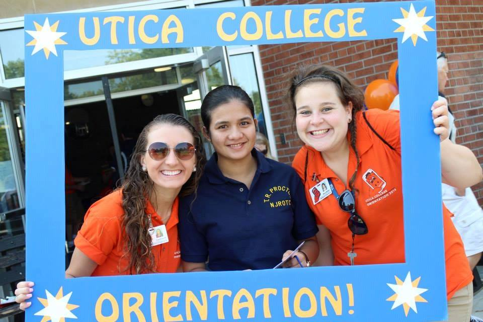 (Fellow mentor [&blogger!] Courtney and I taking a picture with a student from Orientation!)