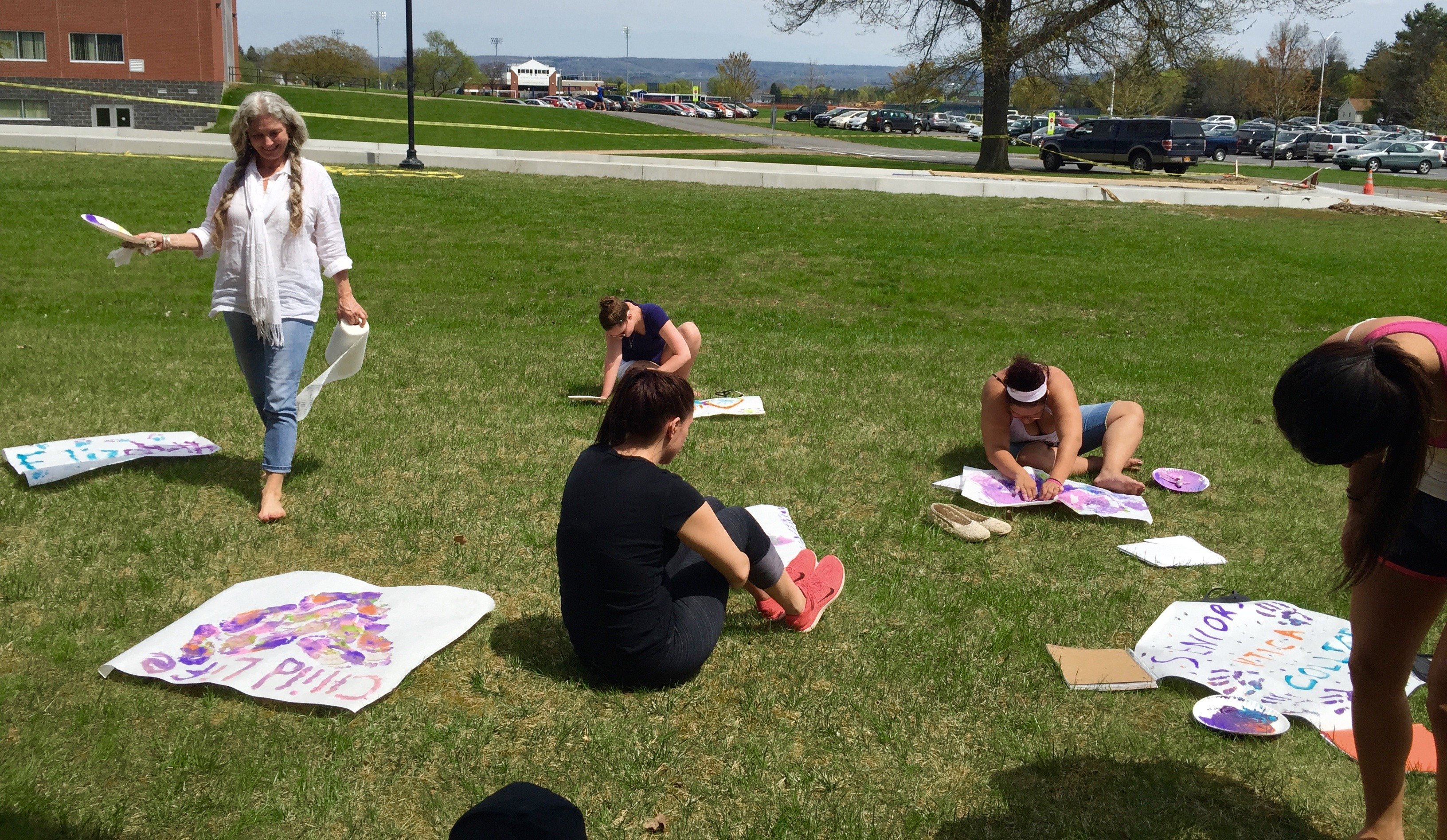 Professor Marris and some of my classmates enjoying play therapy in the sun!